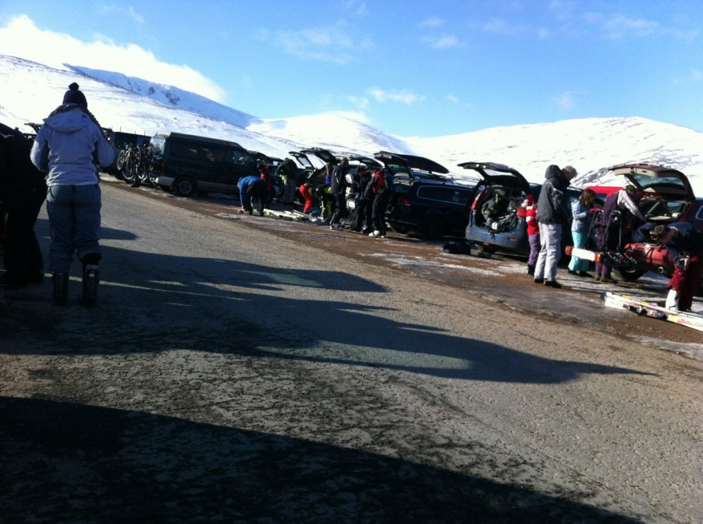 A collection of skiers in the car park