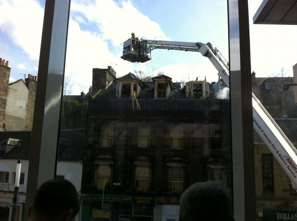 Fire brigade dousing buildings near the shopping centre